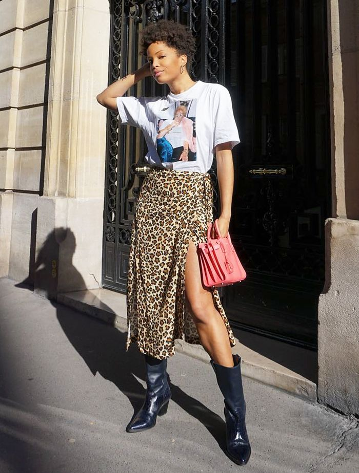 What to wear to concerts: Ellie wears a leopard print skirt and graphic tee