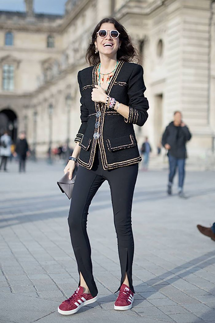 What to wear with leggings: Leandra Medine wears Chanel jacket, Adidas trainers and black leggings