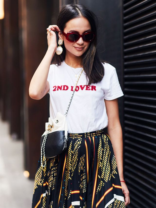 Simple Style Rules: woman wearing slogan tee and large earrings