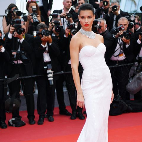 Colours That Suit Brunettes: Adriana Lima in white at Cannes Film Festival