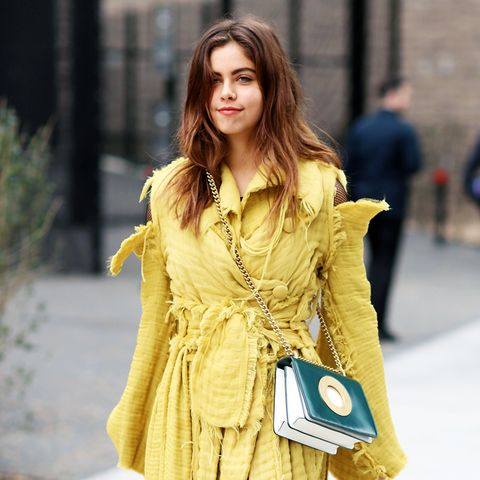 Colours That Suit Brunettes: A pale yellow coat on the streets