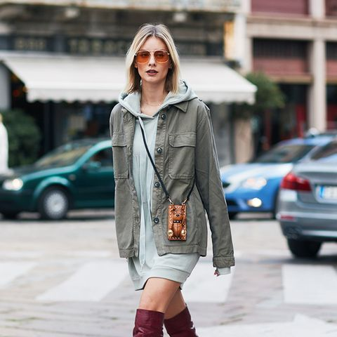 over the knee boots outfits: if you're brave, try an oversized hoodie.