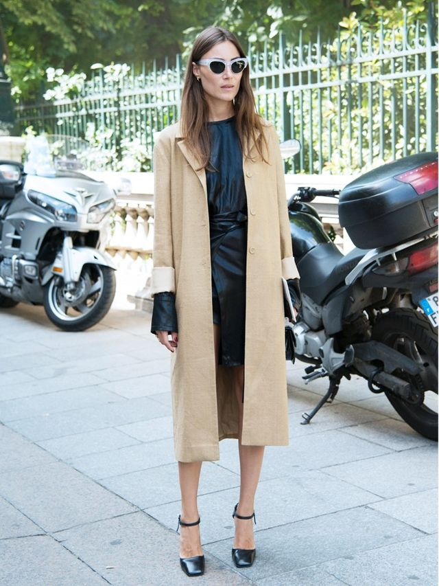 What to wear to an interview: editor wearing camel coat and black dress