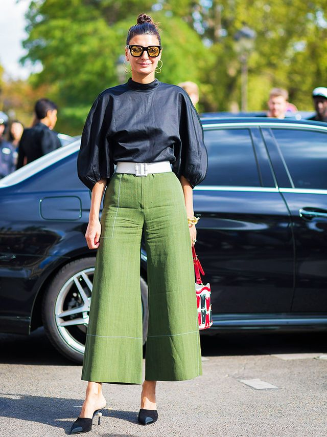 What to wear to an interview: editor wears green trousers and black top