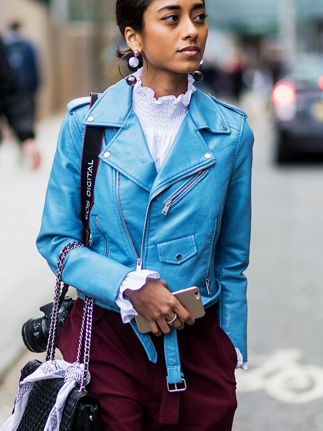 How to Wear a Leather Jacket:  ladylike blouse + contrasting trousers + bold earrings