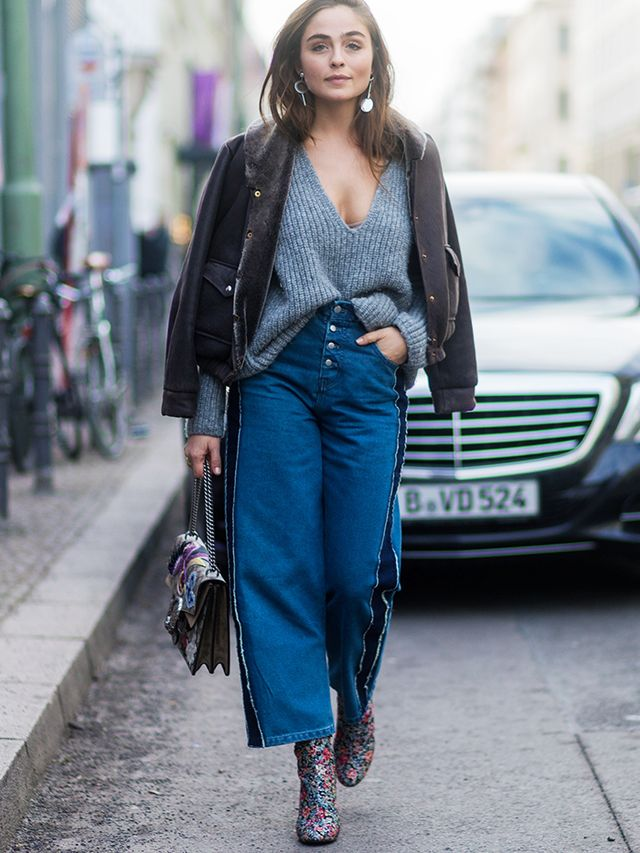 How to wear a leather jacket: Wide-leg trousers + slouchy knit + floral boots