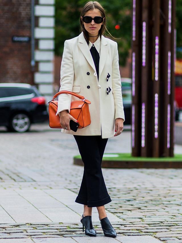How to wear a blazer: a white blazer with black trousers