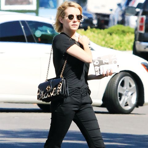 Emma Roberts Style: Black cropped flare jeans and black t-shirt