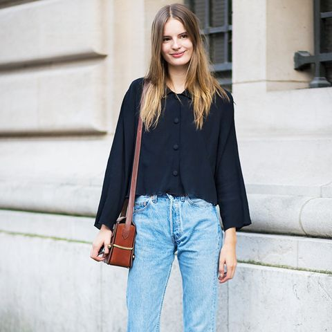 How to wear boyfriend jeans: street style star in straight leg boyfriend jeans and clean hem