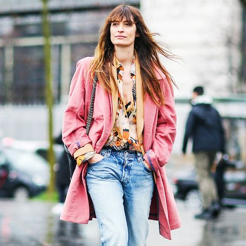 How to wear boyfriend jeans: Caroline de Maigret in boyfriend jeans with a pink jacket and black shoes