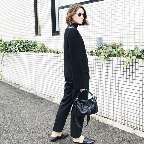 All-black outfits: Charlie May in black flats and a chic jumper