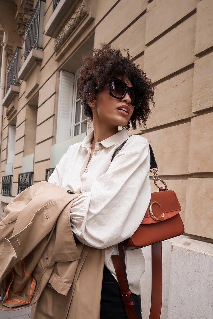 French fashion: Parisian fashion icon Syana wearing a white blouse and a Chloe bag