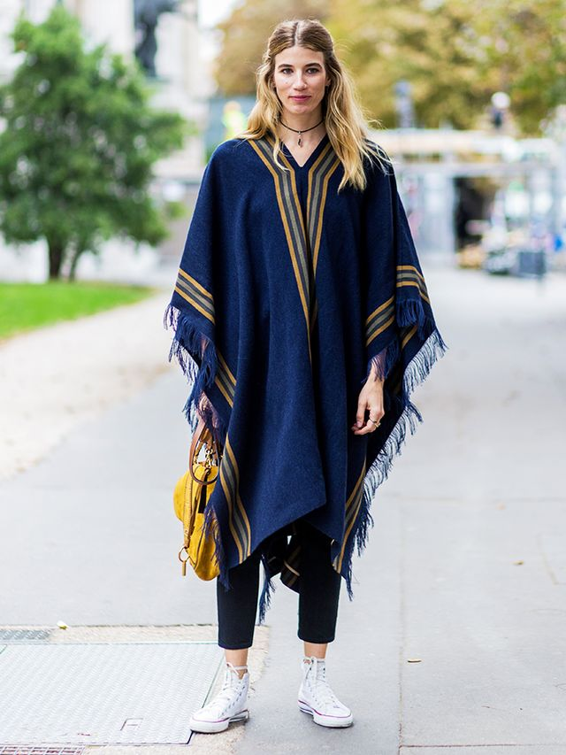 How to Wear Converse: slouchy knit, black trousers, and yellow bag on Veronika Heilbrunner