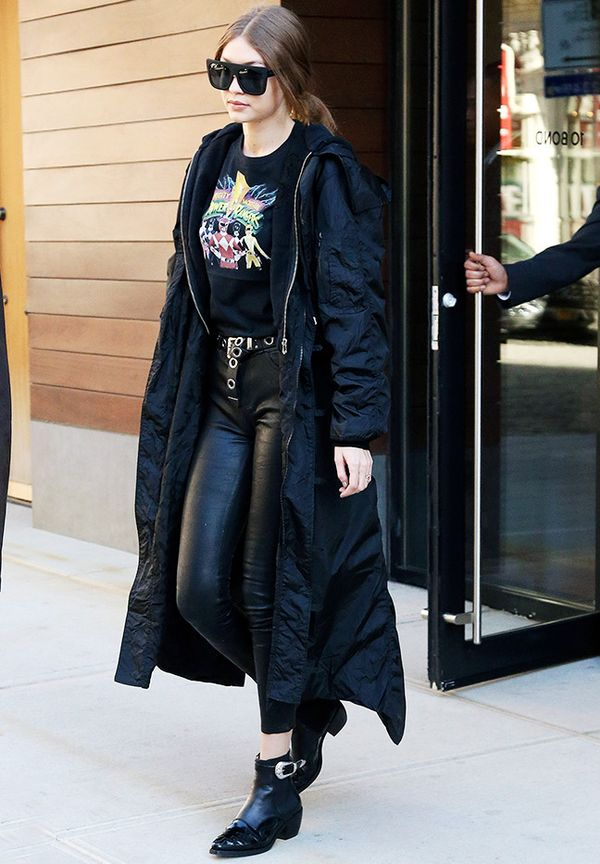Gigi hadid sunglasses: black coat, leather trousers, and Quay sunglasses