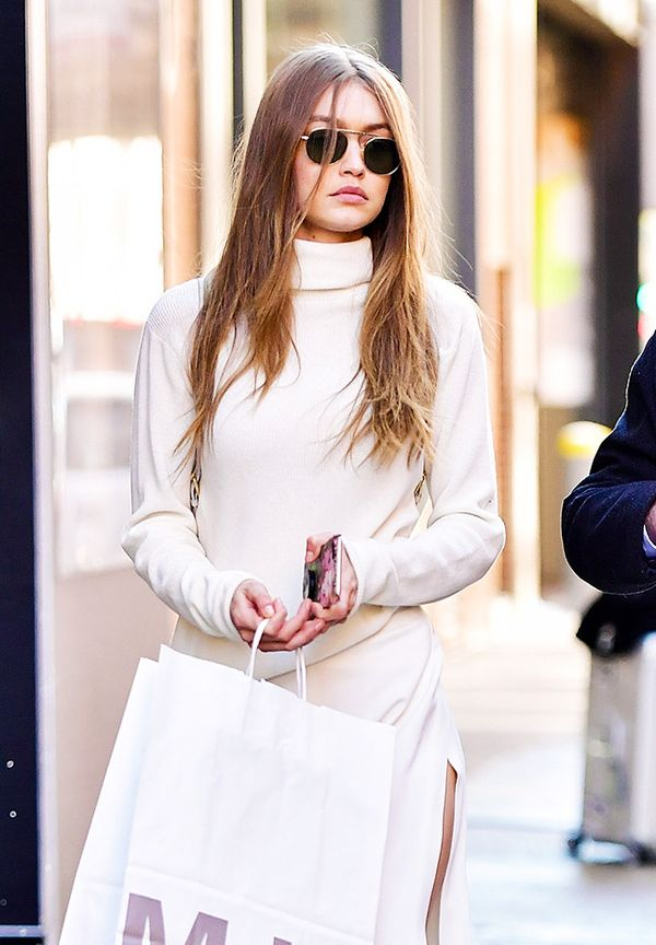 Gigi Hadid Sunglasses: white roll neck, white skirt, and rounded sunglasses