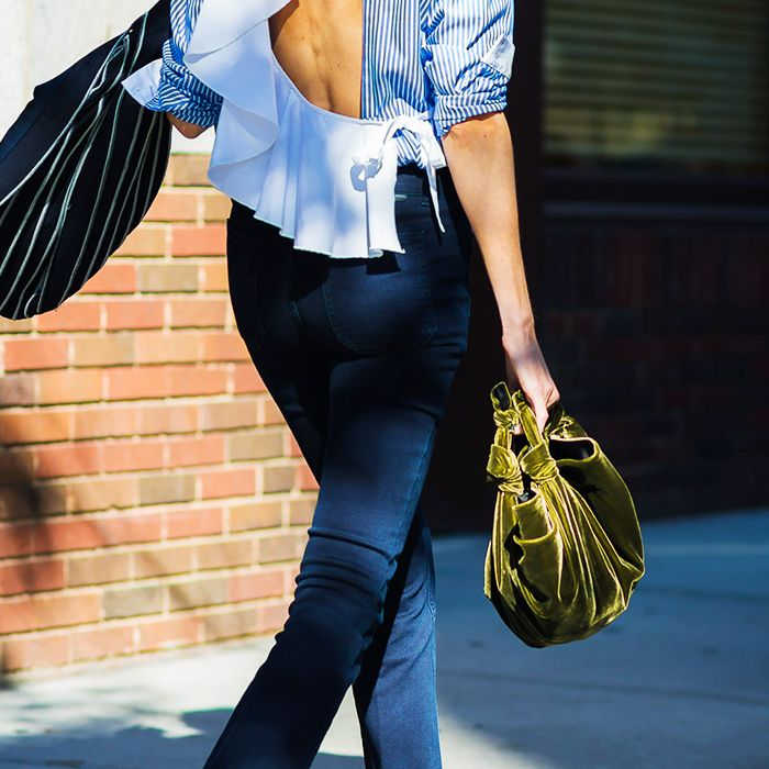 How to wear velvet: woman wearing a velvet bag