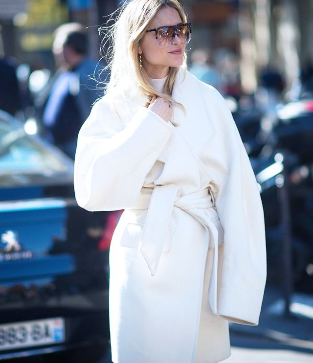 Pernille Teisbaekat Paris Fashion WeekS/S 16. On Teisbaek: Loewe Earrings andFilipa Sunglasses(£295); Joseph Turtleneck Top(£175) in Black; Balmain Coat...