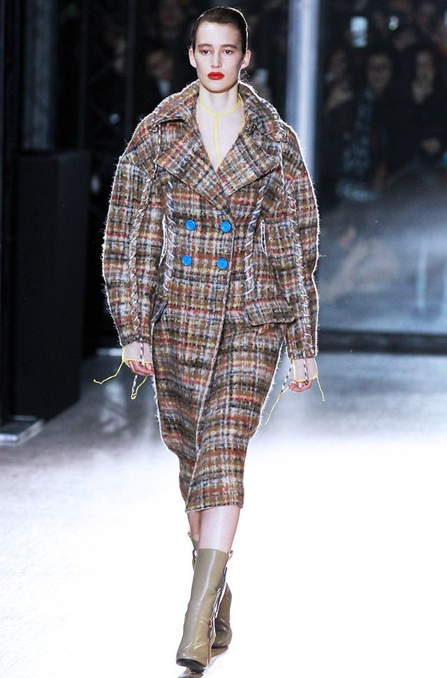 Acne Studios A/W 15 Catwalk Notes:The brand cut a whole new silhouette with its rounded, oversized appearance, open-stitch seams and contrast buttons.