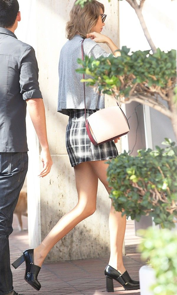 On Swift: Brandy Melville and skirt; Alexander McQueen The Box Shoulder Bag (£1295); & Other Stories shoes.