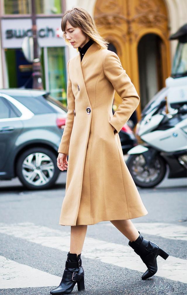 On Ziourova:Stella McCartney Beige Camel Penrose Coat($2445); Pierre Hardy Tom Leather Ankle Boots($1445).