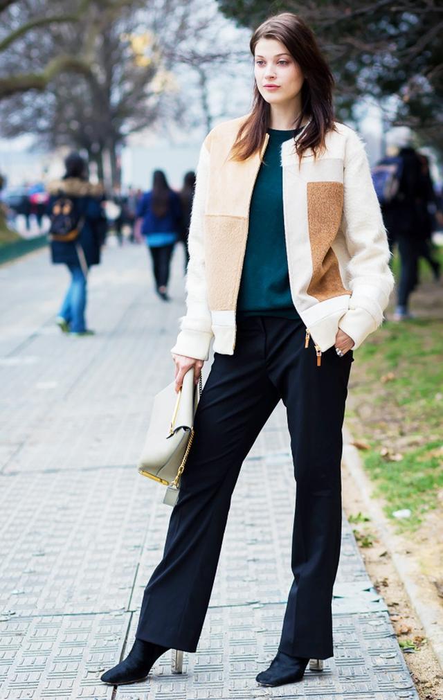 On Hofmann:Prada sweater and pants;Edun Patchwork Jacket($470); Chloé bag; Céline shoes.