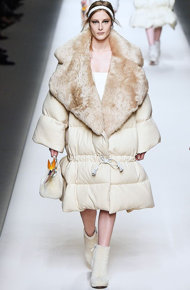 Fendi A/W 15 Catwalk Notes:Matching shearling boots and handbag? Check. Supersize down coat? You bet. Fendi took the streetwise puffa silhouette to new extremes. Warning: This look is only...