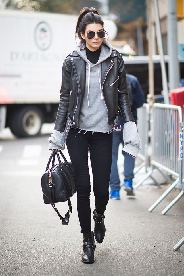 On Jenner: Unravel Oversized Sweatshirt (£266); L'Agence Chantal Skinny Jeans(£145); Saint Laurent Moto Jacket (£3895); sunglasses and boots.