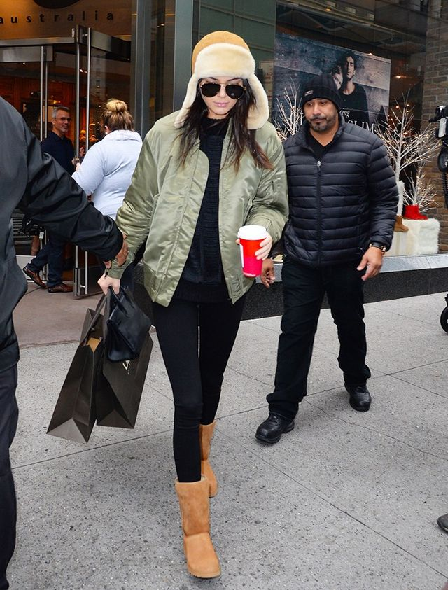 On Jenner: Adidas Originals by Kanye West jacket; UggAmie Wedge(£170); UggTrapper Hat(£142).