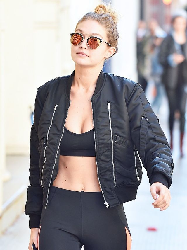 On Hadid: Dior So Real Sunglasses (£361); Saint Laurent Bomber Jacket (£1605).