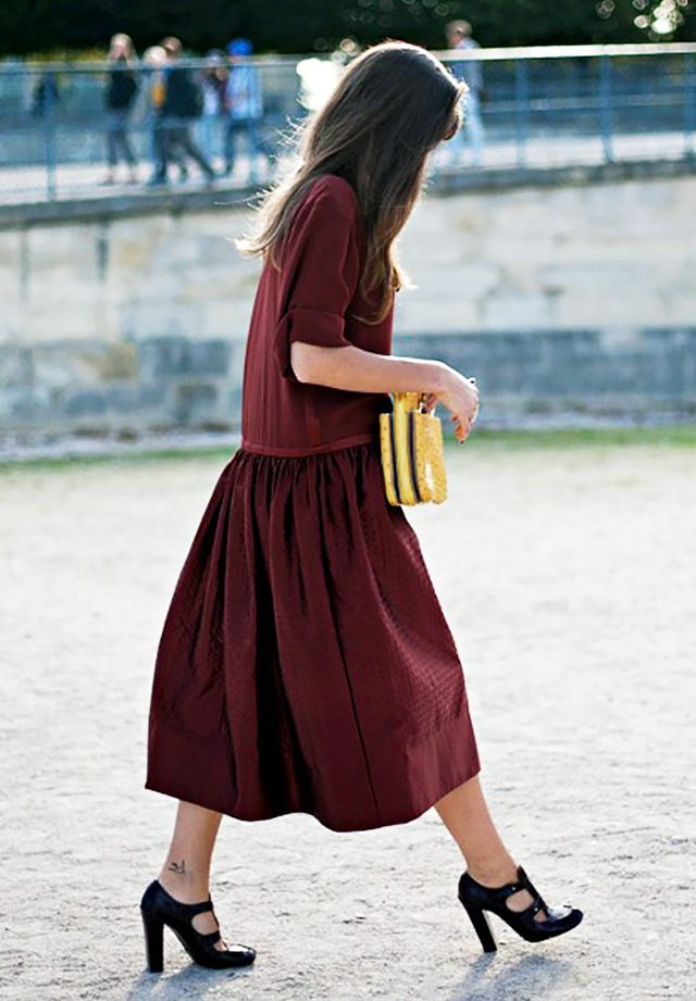 Dresses with a dropped waist create the illusion of a longer torso while maintaining a feminine silhouette.