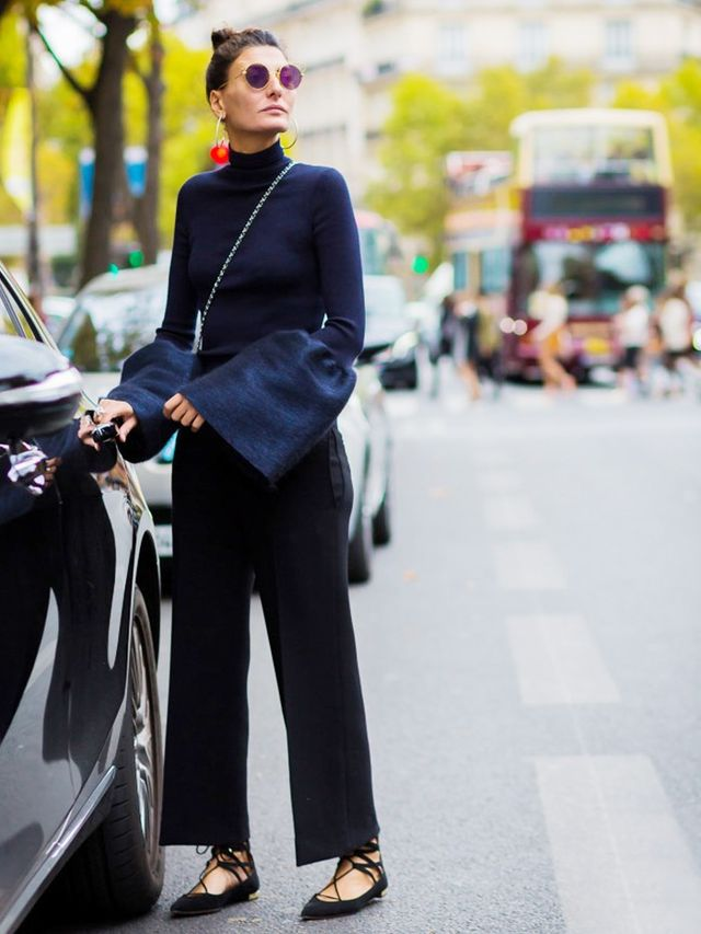 Giovanna Battaglia pairs it with wide-leg trousers and lace-up flats.