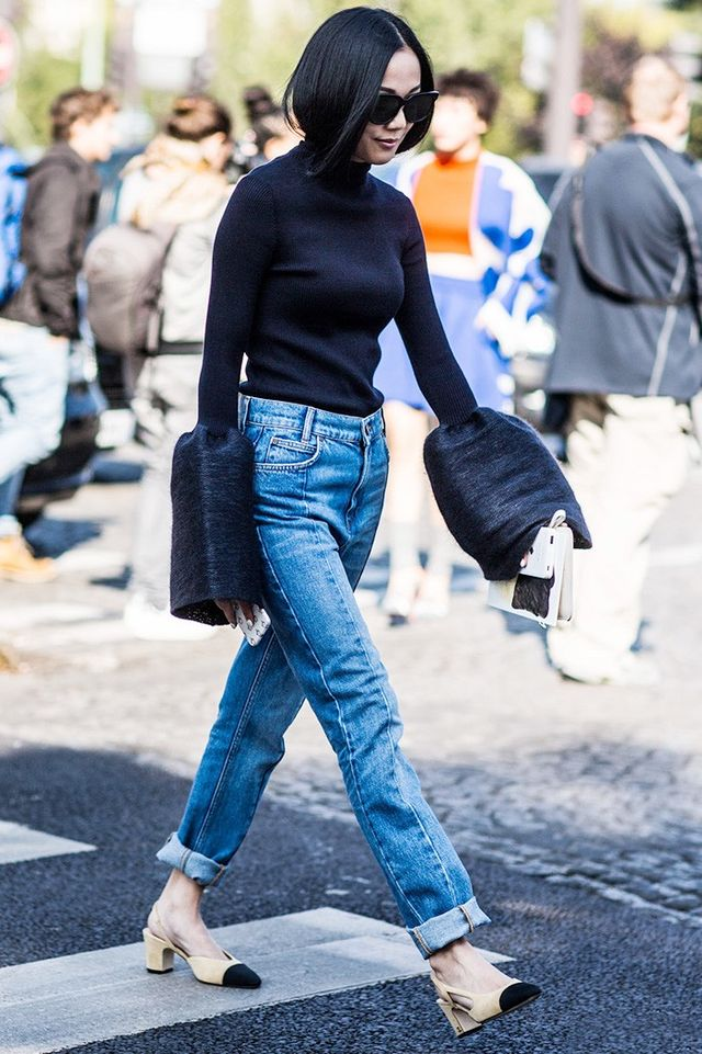 This stylesetter dresses the dramatic sleeves down with a blue denim and Chanel slingback block heels.
