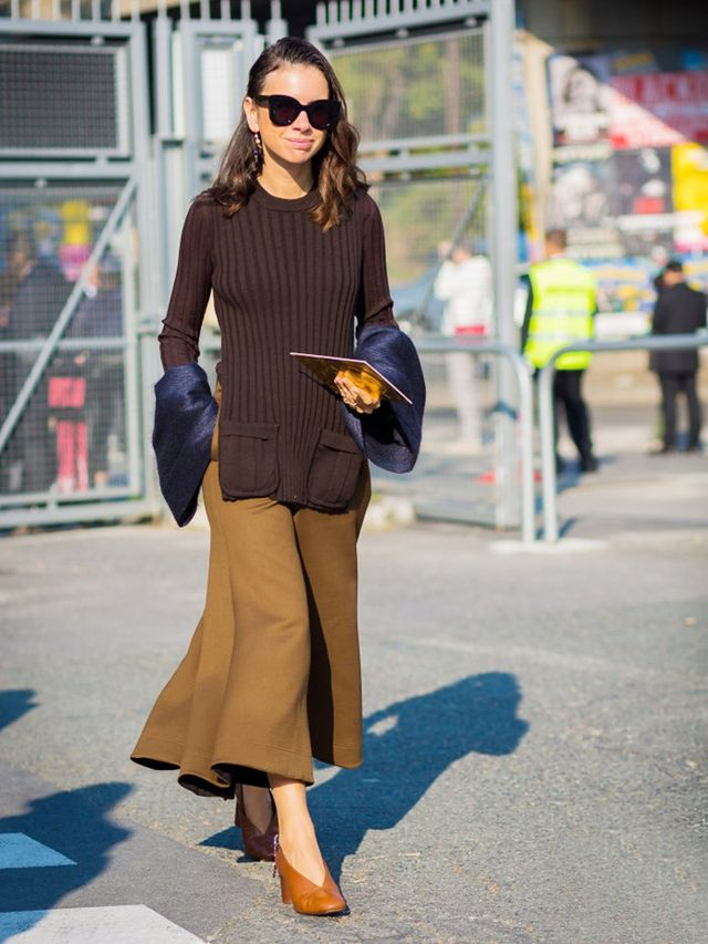 We love how Natasha Goldenberg layered her top over an olive full skirt and accessorized with embellished Céline pumps.