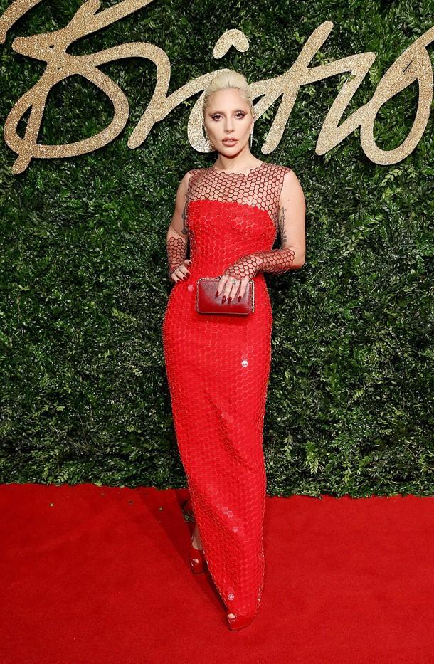 WHO: Lady Gaga WEAR: Tom Ford dress; Bulgari earrings and clutch; Giuseppe Zanotti pumps.