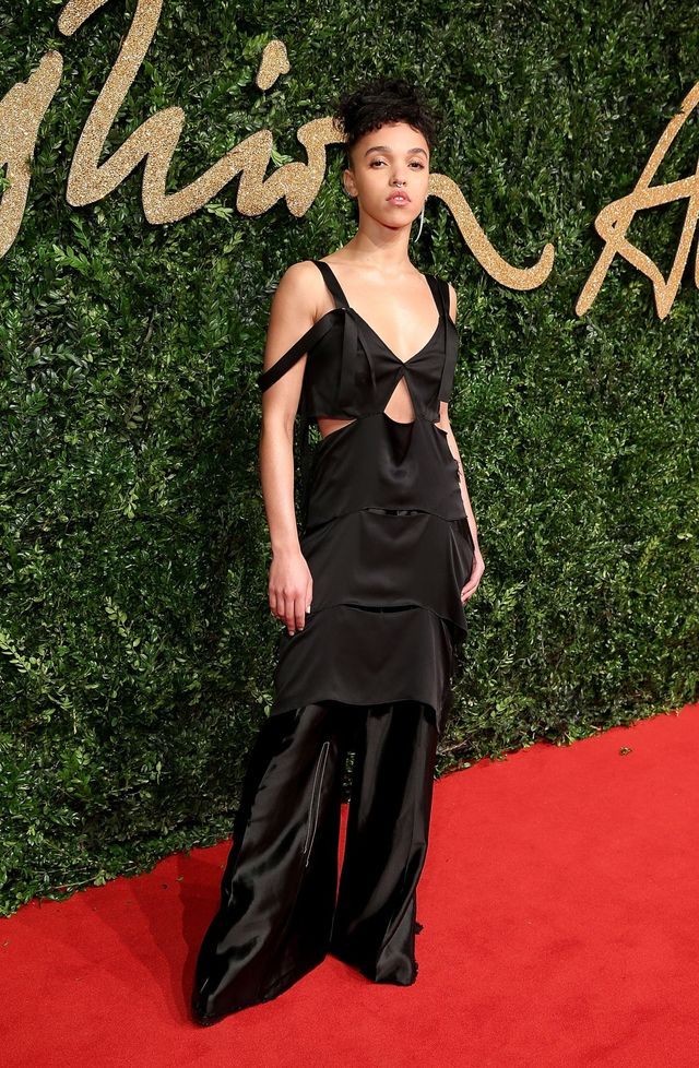 WHO: FKA Twigs WEAR: Calvin Klein Collection black silk split seam dress and silk charmeuse trouser from the S/S 16 collection; Shaun Leane earring.