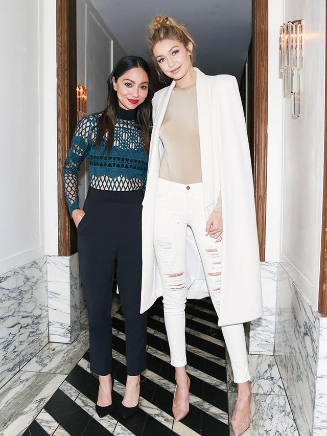 On Monica Rose: Self Portrait Lace and Crepe Jumpsuit(£250). On Gigi Hadid: Olcay Gulsen cape; Tamara Mellon top; J Brand 23110 Maria Jeans(£170)