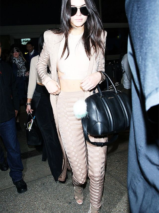 On Kendall Jenner: Balmain Stretch Viscose Long Cardigan(£1,440)and trousers; House of CB crop top; Givenchy bag.