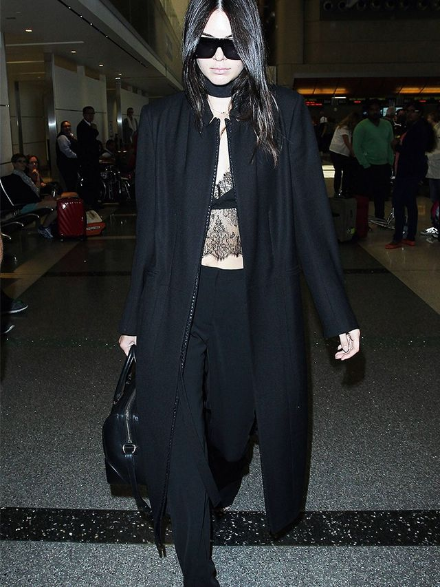 On Kendall Jenner:Céline sunglasses; Ann DemeulemeesterBlack Wool Layered Coat(£1,230); Sharon Wauchob top; Sally LaPointe trousers;Givenchy bag.