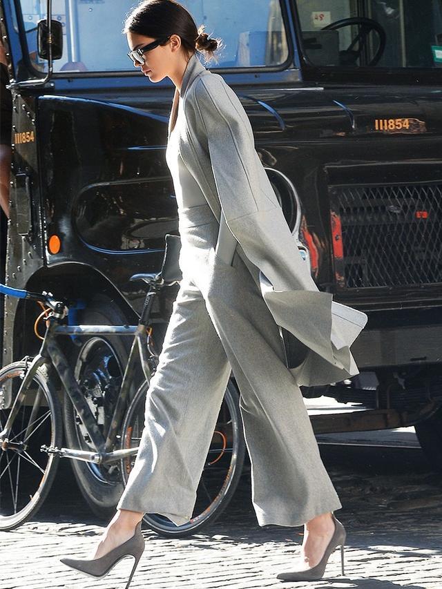 On Kendall Jenner:Céline sunglasses; Sally LaPointe cape and trousers; Atea Oceanie Crawford Bodysuit(£95); Saint Laurent Paris Pumps(£395) available in Black...