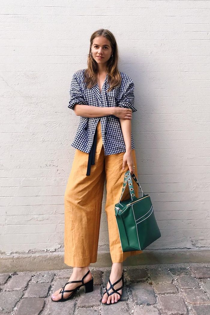 style blogger weekend casual outfits: Trine Kjær wearing yellow trousers and gingham blazer