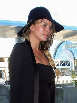 Chrissy Teigen Nails Airport Style in a Maternity LBD