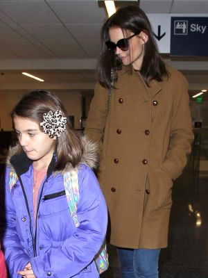 Katie Holmes and Suri Cruise Opt for Chic Ankle Boots at the Airport