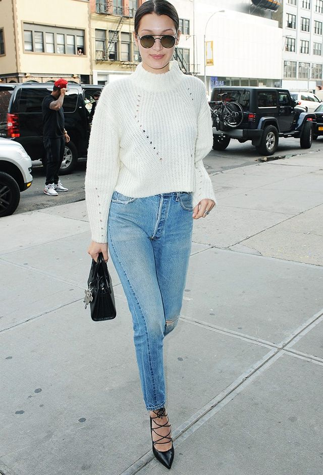 On Bella Hadid:Unif sweater; ReDone jeans; Saint Laurent bag and shoes.