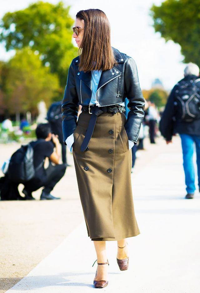 Natasha Goldenberg pairs her short leather jacket with a high-waisted midi skirt and a pair of ankle-strap heels. Office outfit: planned.