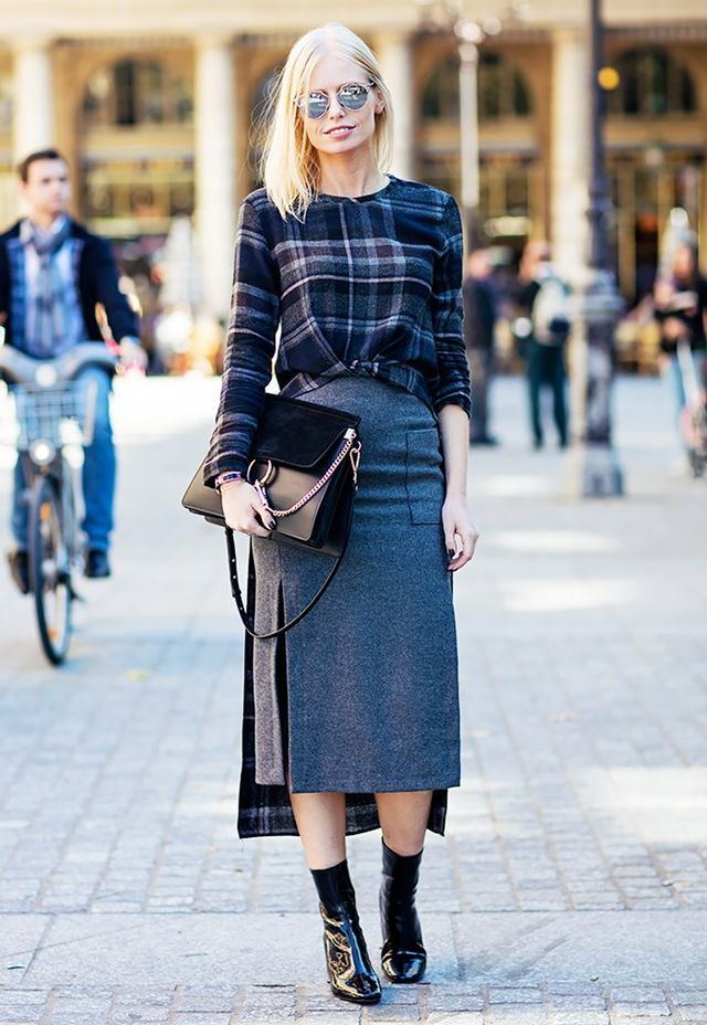 3. Printed sweater, midi skirt, and ankle boots.