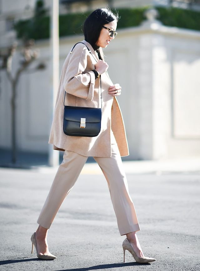 4. Monochrome coat, trousers, and pumps.