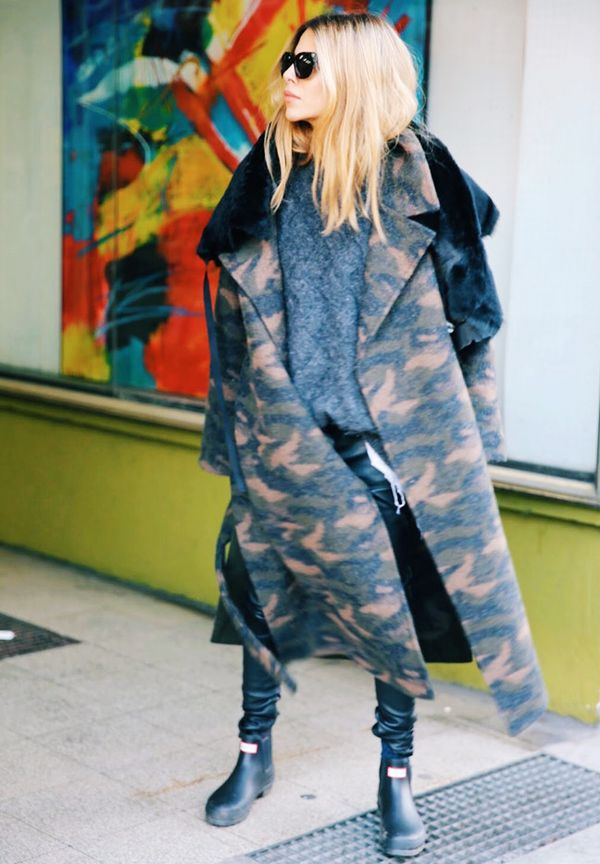 Style Notes:Camo-print coat? Check. Grey sweater? Check. Functional footwear? Check. Maja Wyh definitely ticks all the must-have seasonal buys, including those Hunter boots that are as chic...