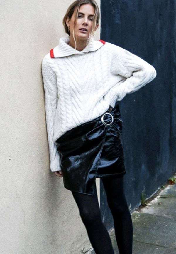Style Notes:A white cable-knit jumper paired with a luxe miniskirt and tights is the ideal wintry ensemble.