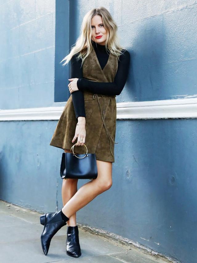 Make a dress winter-ready by layering a black turtleneck underneath.