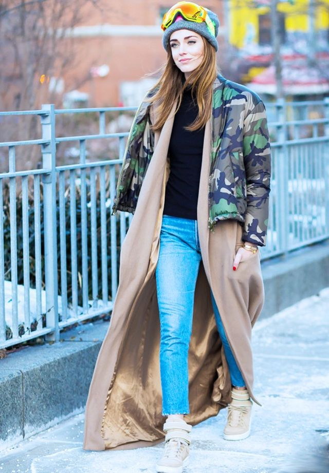 Style Notes: A floor-length camel coat can be chilled out with a cropped puffa. Snow goggles optional, obvs. Read all about how Vogue editors are obsessing over puffa coats!